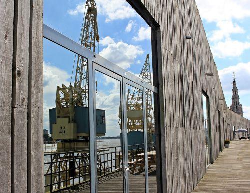 harbour cranes mirroring hanger