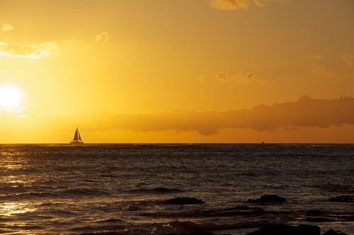 hawaii sunset sailboat