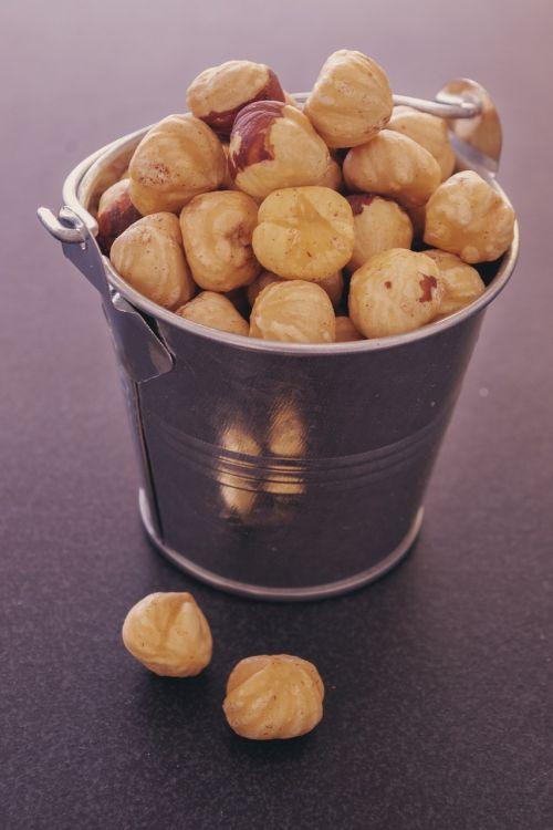 hazelnuts metallic bucket food food photography