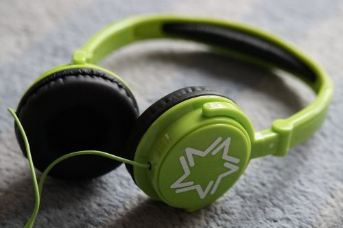headphones green listen to music