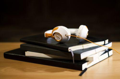 headphones notepad notebook