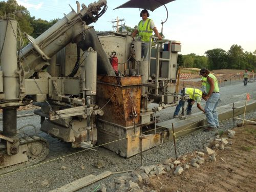 heavy equipment working curb and gutter laying curb and gutter