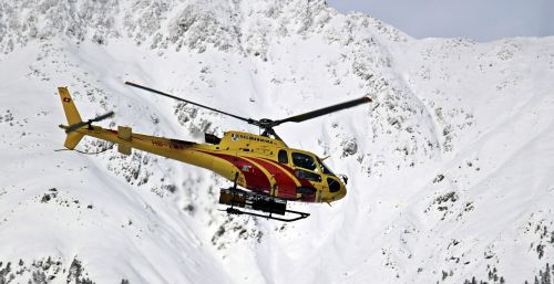 helicopter mountains snow