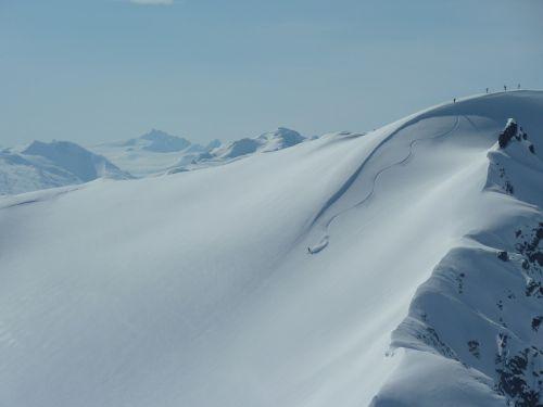 heliskiing canada deep snow driving yukon territory