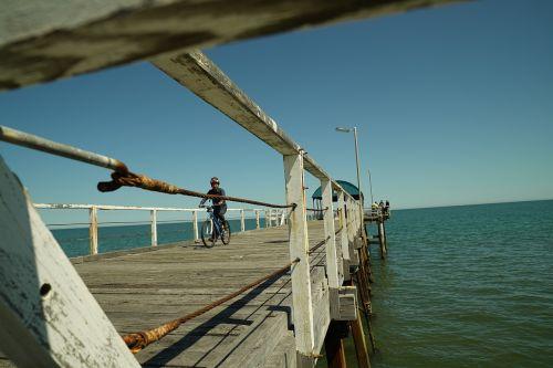 henley beach jetty cyclist