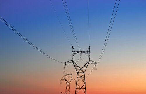 high-voltage tower  tower of electricity  sunset