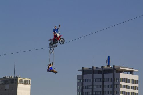 high-wire artist motorcycle rope
