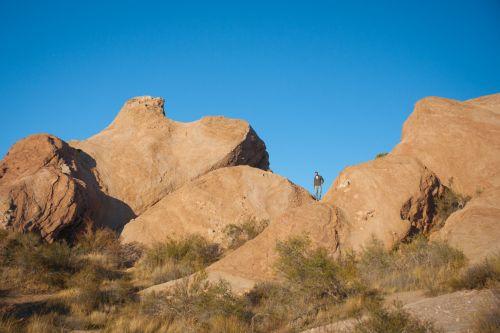 Hiker On Boulder Rocks