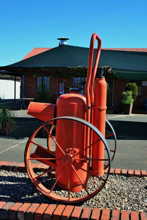 Historic Fire Extinguisher On Wheel