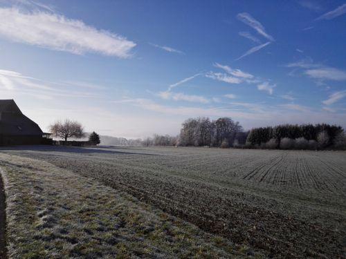 hoarfrost blue sky field
