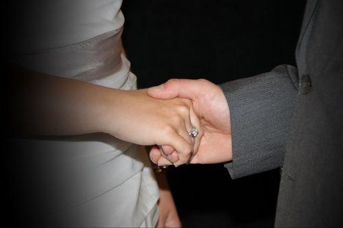 holding hands wedding ring