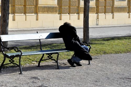 homeless park bench person