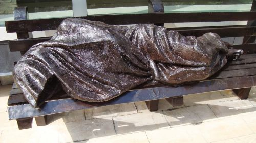 homeless statue city streets