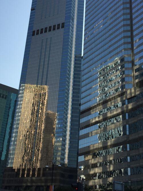 Honkongas,dangoraižiai,atspindys,bokštas,miestas,architektūra,miesto panorama,miesto