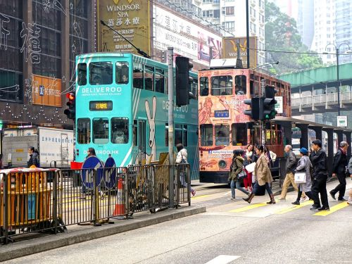 hongkong,ting ting car,tram,double decker tram,city,building,signboards,road,city street,transportation,urban,urban city,traffic,travel,tourism,people,pedestrian,crossing