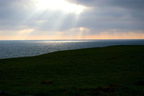 horizon opening ray of light