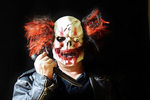 horror clown mass murderer knife