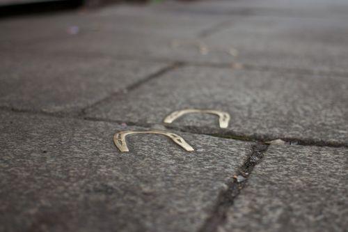 horseshoes sidewalk ground