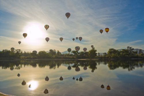 hot air balloon balloon and wine festival floating over lake