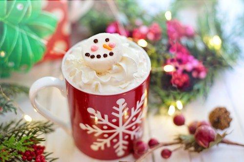 hot chocolate  whipped cream  snowman marshmallow