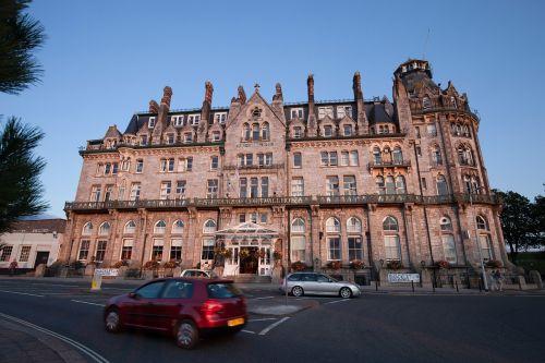 hotel,tudor style,windsor,english architecture,gothic style elements,facade,road,autos