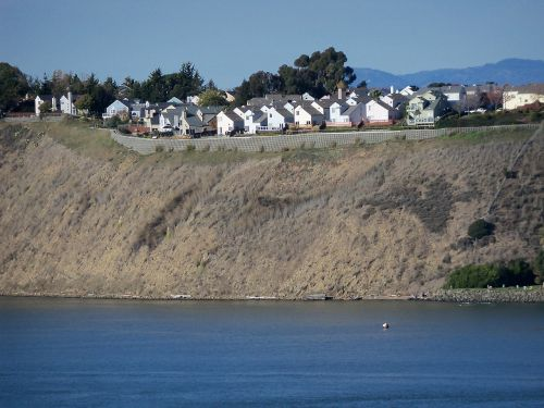 houses cliff water