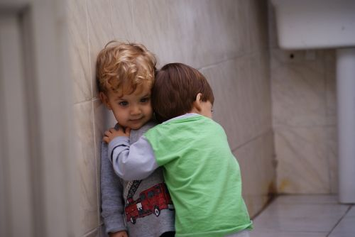 hug brother child