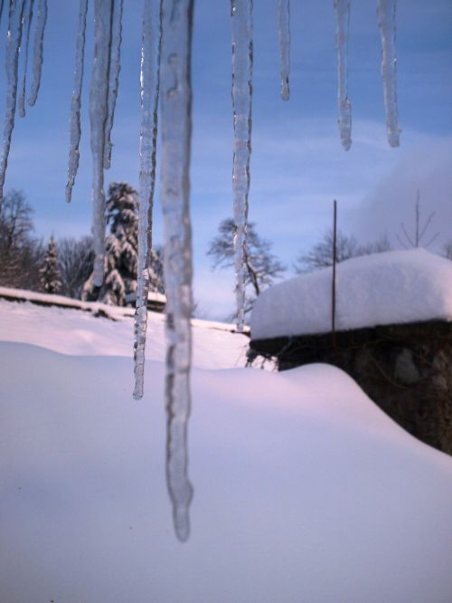 icicle snowshed blue sky