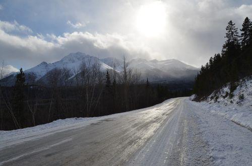 icy road mountain sun