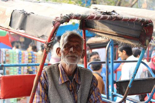 indian old man rickshaw puller