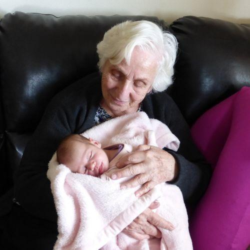 infant newborn grandmother
