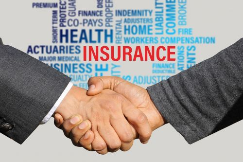 insurance contract shaking hands