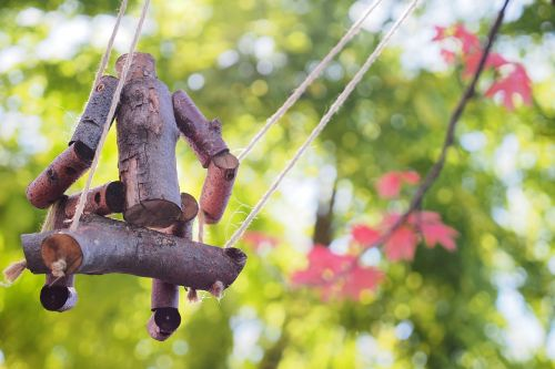 swing wooden figure