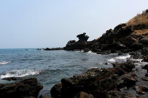 jeju island  yongduam rock  jeju island beach