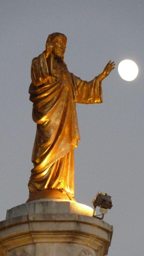 jesus statue moon