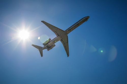 Jet Airplane In The Sky With Sun