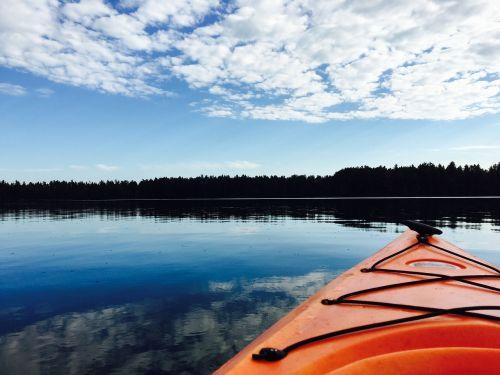 kayak water clouds