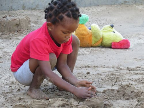 kid playing beach