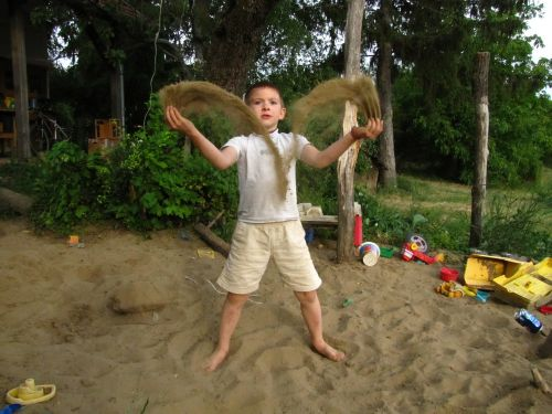 kid plays sand
