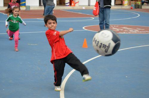 kid soccer kick