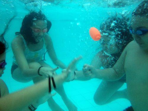 Kids Playing Underwater