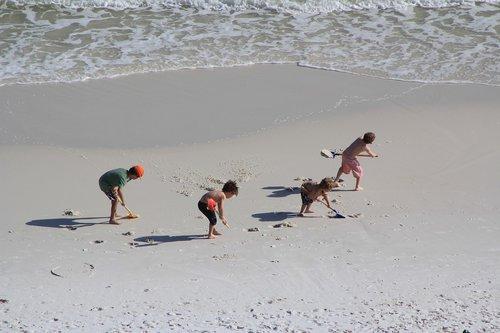 kids working  kids on a beach  sand