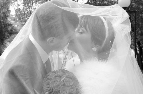 kiss the groom bride