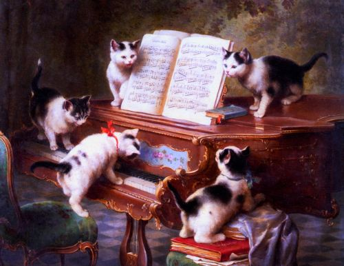 Kittens Playing The Piano