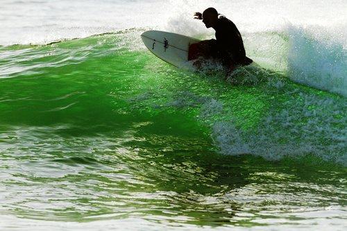 knee boarding  waves  morning