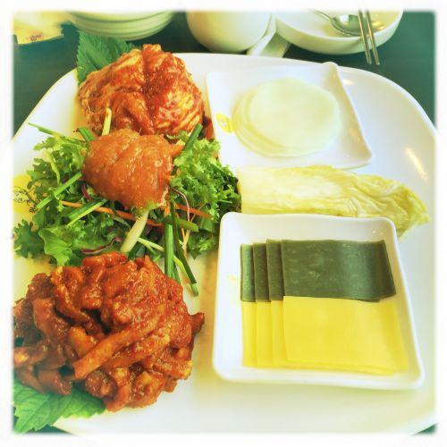 korean meal spicy pork wrap
