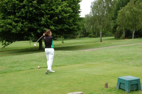 Lady Golfer In Action