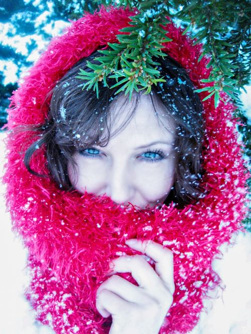 lady in red in the snow snowfall