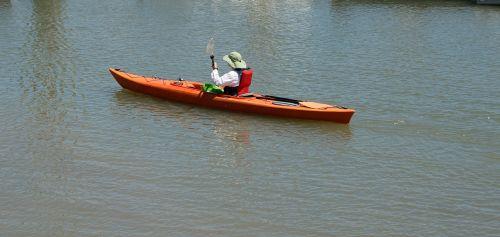lady kayaking background person