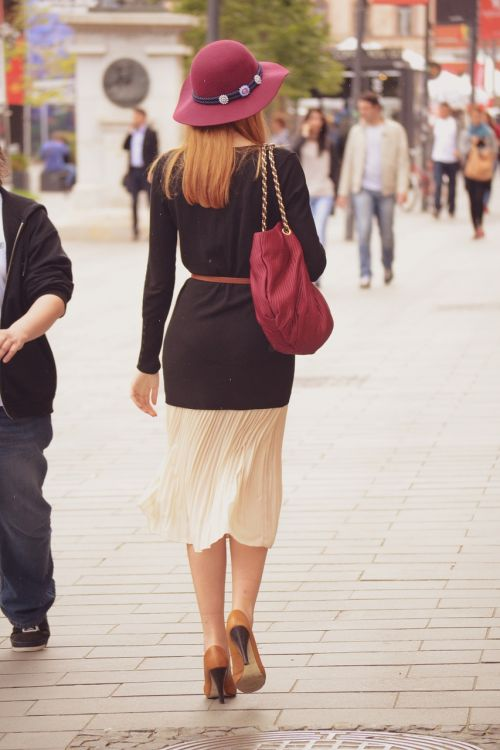 lady walking on the street walking away elegant woman